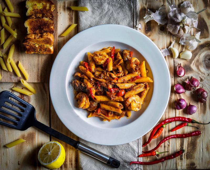 Hot penne pasta stock photography
