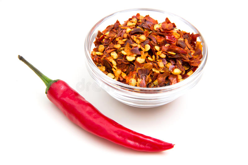 Hot peppers ground. Ground hot pepper on a white background royalty free stock image
