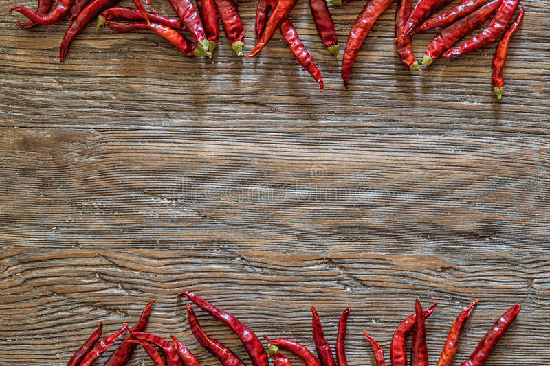 Hot peppers on old wooden table background royalty free stock images