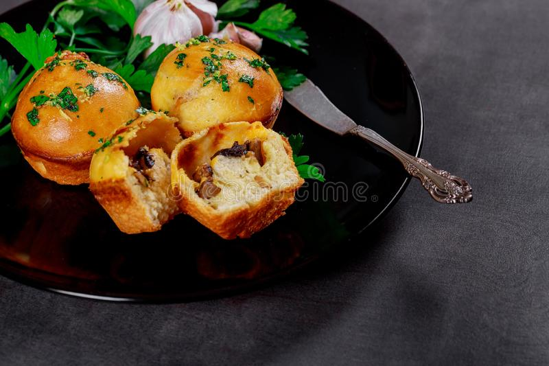 Hot pies with mushrooms and garlic on wooden gray boards royalty free stock photos