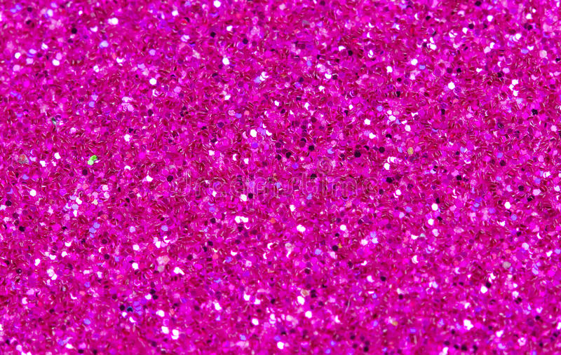 Hot pink abstract background. Pink glitter closeup photo. Pink shimmer wrapping paper. royalty free stock images