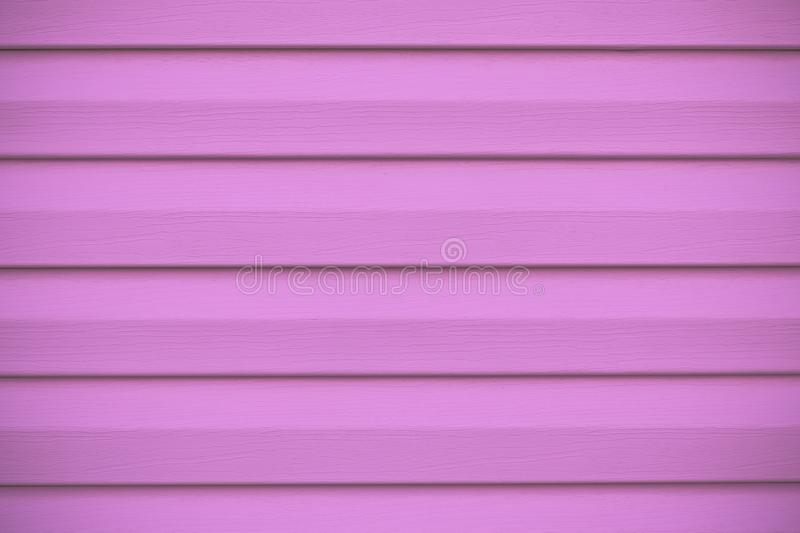 Hot pink striped fence. Facing surface, wooden texture. Coating background. Abstract pattern of wood planking. Decorative purple f stock images