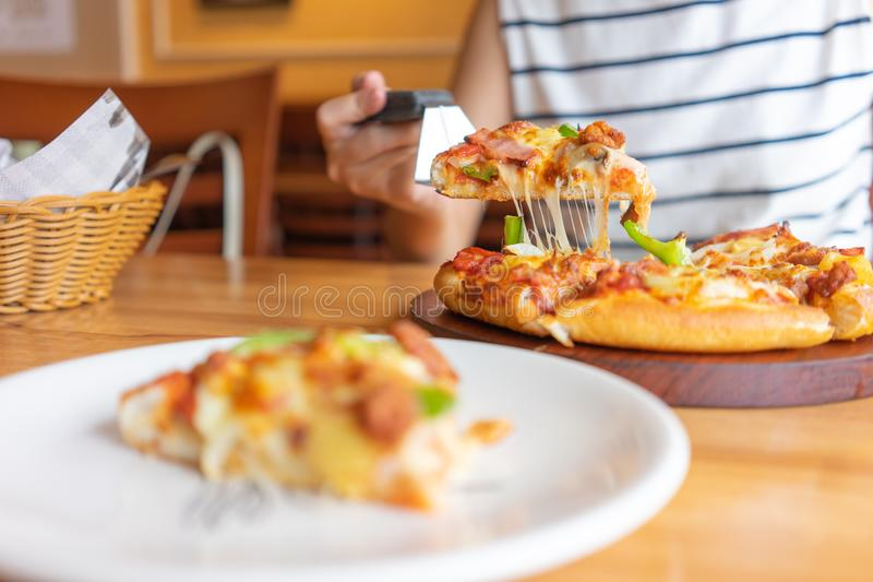 Hot pizza dip tray of pizza toppings include ham, pork, paprika and vegetables, pizza, Italian food saurian. View from side. Hot pizza dip tray of pizza toppings stock images
