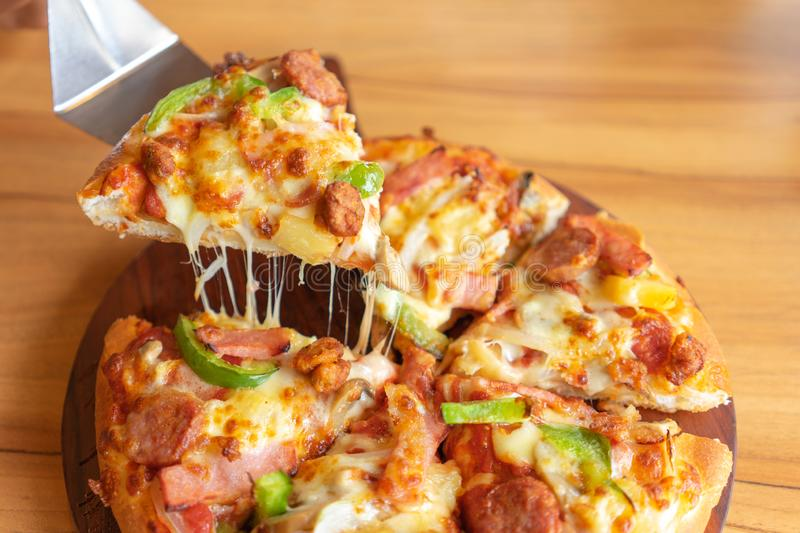 Hot pizza dip tray of pizza toppings include ham, pork, paprika and vegetables, pizza, Italian food saurian. View from side. Hot pizza dip tray of pizza toppings royalty free stock photography