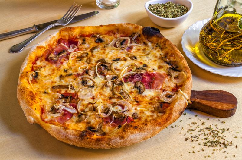 Hot pizza with parma ham, onions and mozarella cheese. royalty free stock image