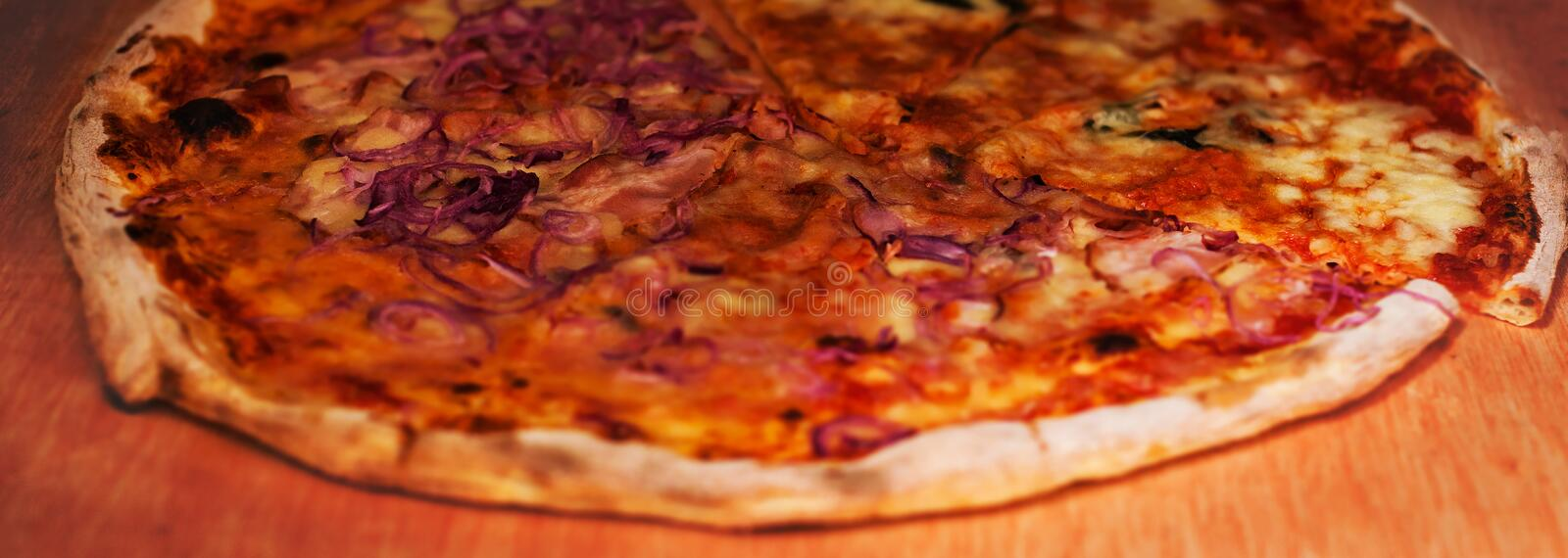 Hot pizza with Pepperoni Sausage with basil and cheese on a sta stock photos