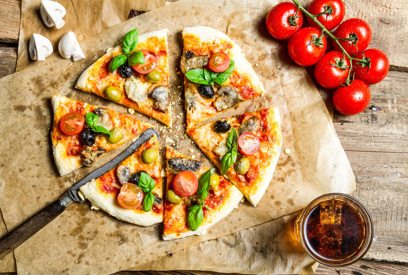 Hot pizza served with a cold drink stock photos