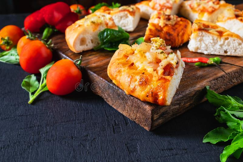.Hot pizza on wooden tray for pizza. Hot pizza on wooden tray for pizza nAnd spices stock photography