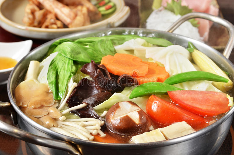 Hot pot. On the table stock photo