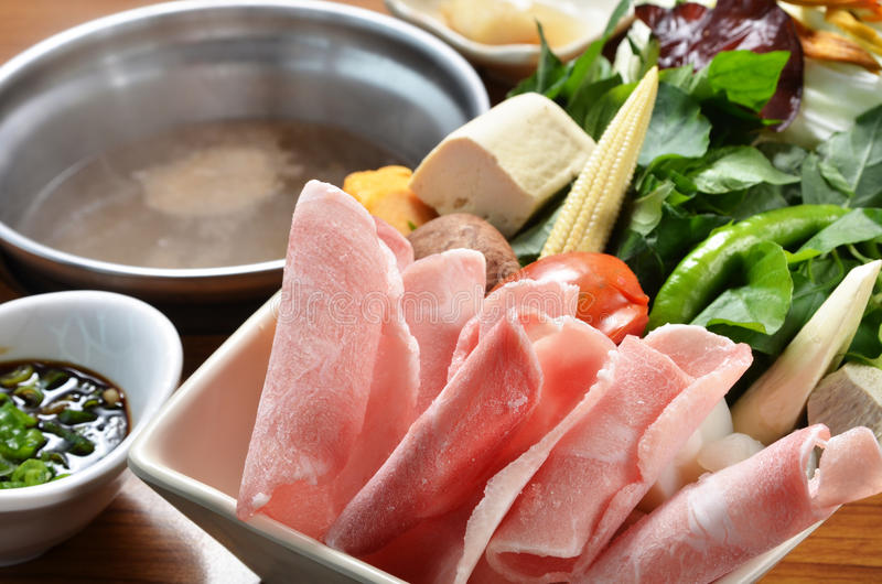 Hot pot. Chinese hot pot with meat, tofu, vegetable royalty free stock photos
