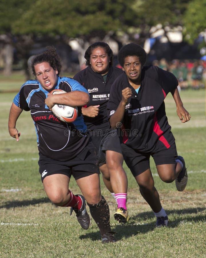 Hot Pursuit. Event: 2013 Rugby Championship, 08-12.X.13 Location: Queen Kapi'olani Park, Waikiki, on the island of O'ahu, Hawai'i, USA Subject: Kalihi Raiders ( stock images