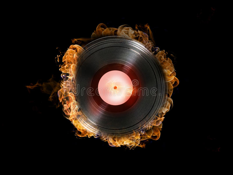 Hot Record. Vinyl record on fire on black background royalty free stock photography