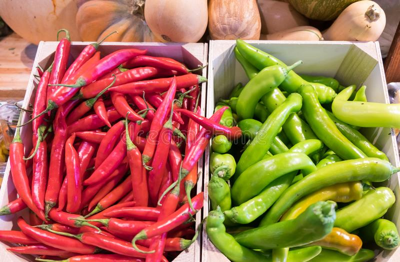 Hot red and green chili peppers at farmers market. Hot red and green chili peppers at local farmers market royalty free stock photography