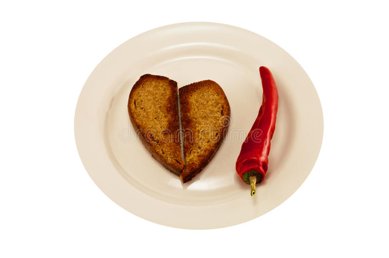 Hot red pepper and heart toast stock images