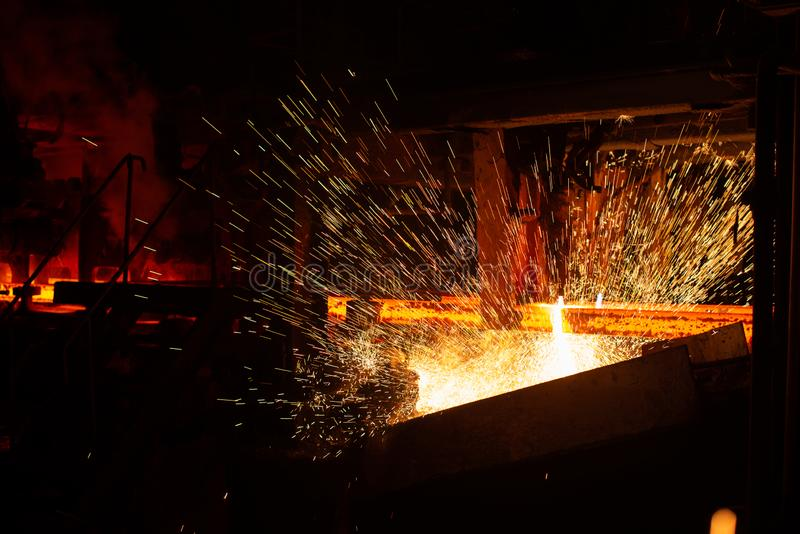 Hot red steel billets at torch cutting. Background of the blacksmith and metallurgical industry.  stock image
