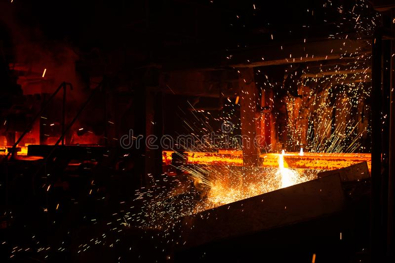 Hot red steel billets at torch cutting. Background of the blacksmith and metallurgical industry.  royalty free stock image