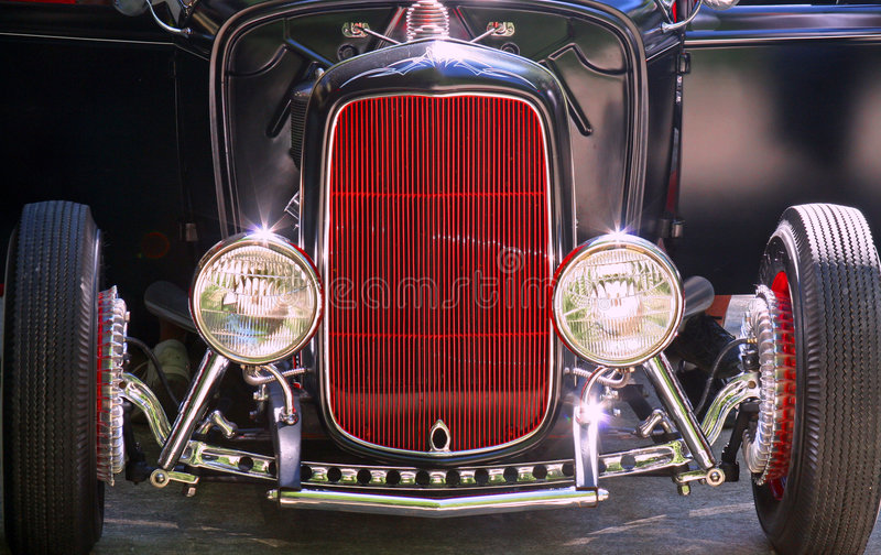 Hot rod. A front view of a black and red hot rod roadster stock photos