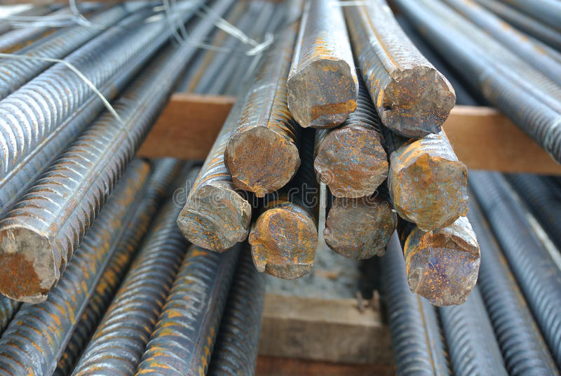 Hot rolled deformed steel bars a.k.a. steel reinforcement bar. SELANGOR, MALAYSIA – FEBRUARY 10, 2015: Hot rolled deformed steel bars used at construction royalty free stock photos