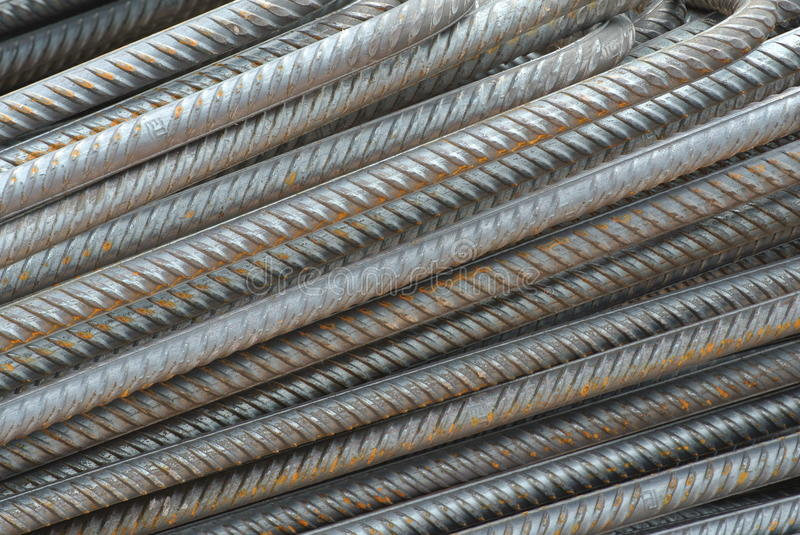 Hot rolled deformed steel bars a.k.a. steel reinforcement bar. SELANGOR, MALAYSIA – FEBRUARY 10, 2015: Hot rolled deformed steel bars used at construction royalty free stock photo