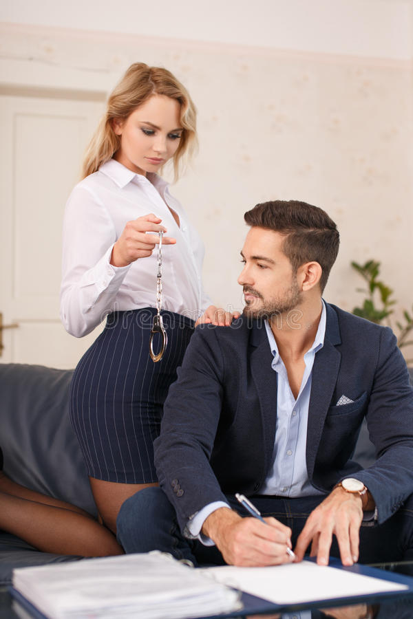 hot secretary offering handcuffs for young ceo stock image - image