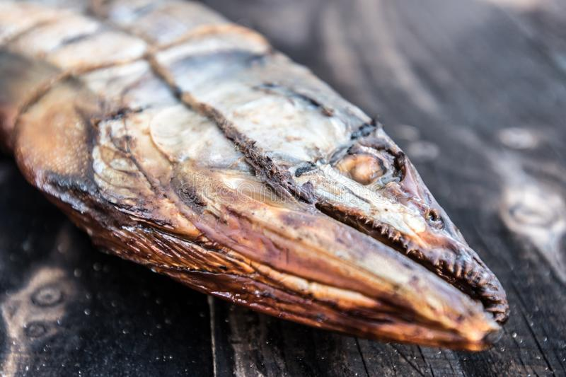 Hot smoked fish. Pink salmon. The concept of tasty and healthy ecological food royalty free stock photo