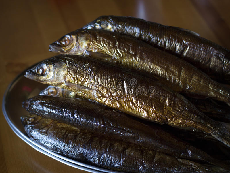 Hot smoked Omul (endemic species of fish in the lake Baikal, Russia). royalty free stock photography