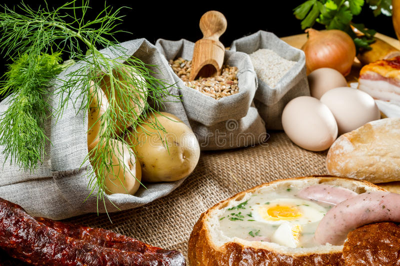 Hot soup served in bread with egg on Easter stock image