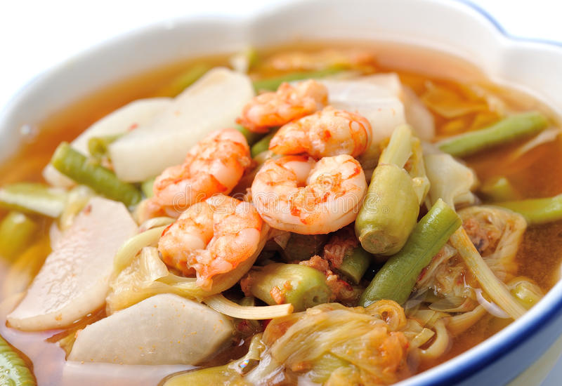 Hot and sour curry with tamarind sauce, shrimp and vegetables. (kang som koong royalty free stock images