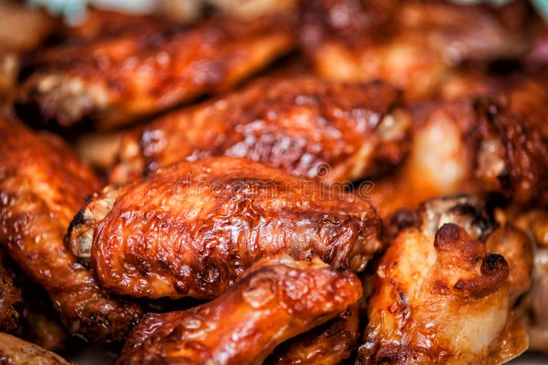 Hot and spicy buffalo style chicken wings. Hot buffalo style chicken wings food fried spicy bbq barbecue fresh appetizer meat roasted sauce cuisine delicious pub royalty free stock photos
