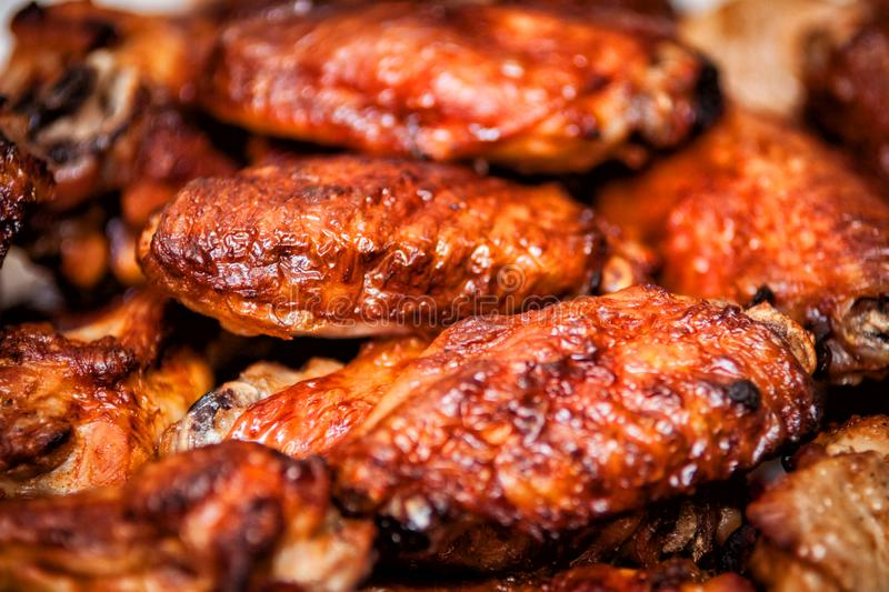 Hot and spicy buffalo style chicken wings. Hot buffalo style chicken wings food fried spicy bbq barbecue fresh appetizer meat roasted sauce cuisine delicious pub stock image