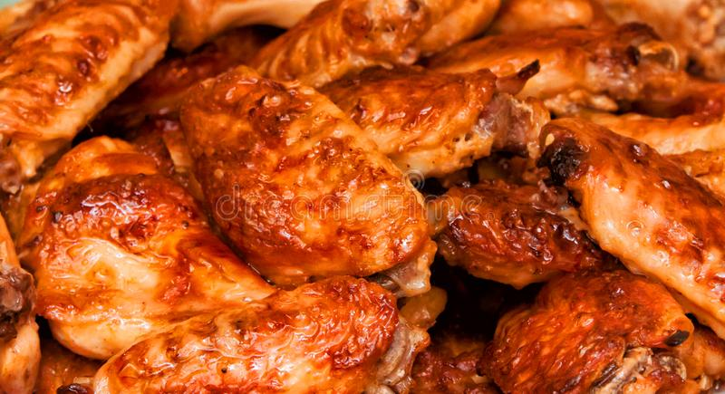 Hot and spicy buffalo style chicken wings. Hot buffalo style chicken wings food fried spicy bbq barbecue fresh appetizer meat roasted sauce cuisine delicious pub stock photography
