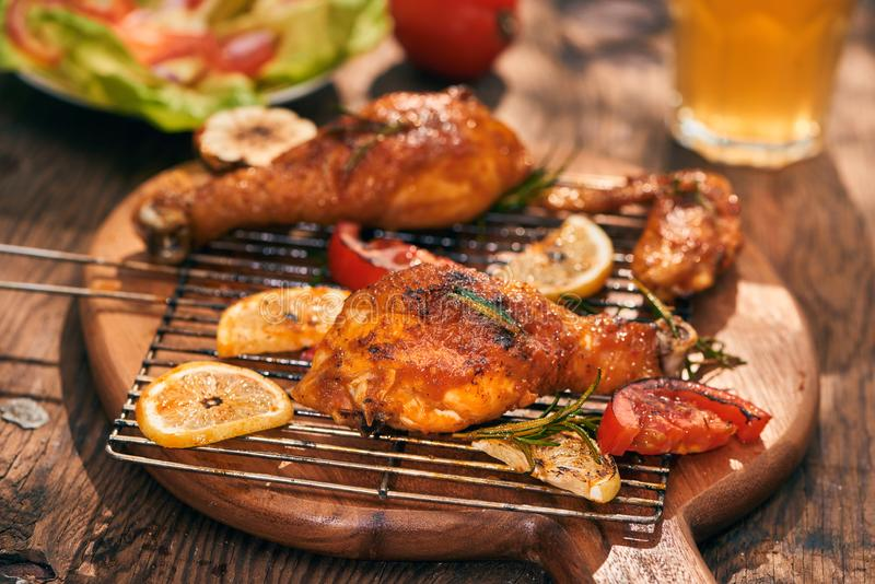 Hot and spicy chicken drumstick and wings closeup with beer royalty free stock photos