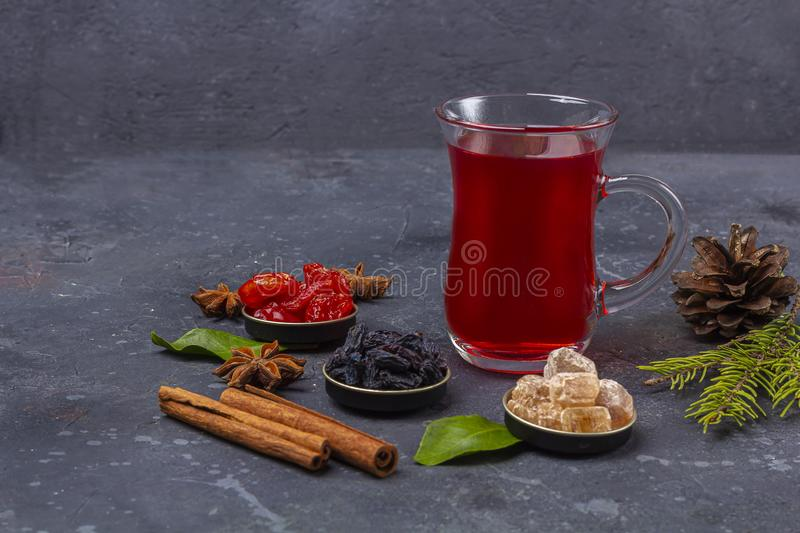 Hot spicy Christmas home made drink. Mulled wine, cranberry punch or Sangria with cranberries and orange for Christmas feast in. Oriental style. Winter holidays stock image