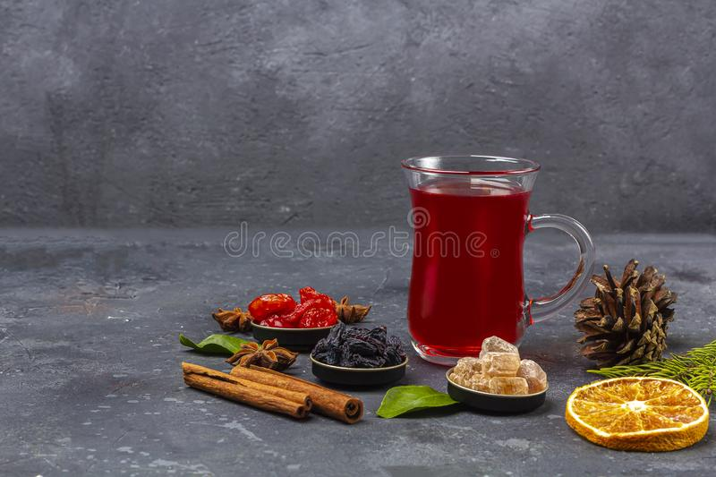 Hot spicy Christmas home made drink. Mulled wine, cranberry punch or Sangria with cranberries and orange for Christmas feast in. Oriental style. Winter holidays royalty free stock photos