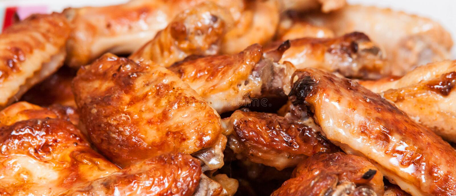 Hot and spicy, delicious deep fried buffalo chicken wings. Delicious deep fried buffalo chicken wings, appetizer, barbecue, bbq, food, fast, meal, meat, sauce royalty free stock photography