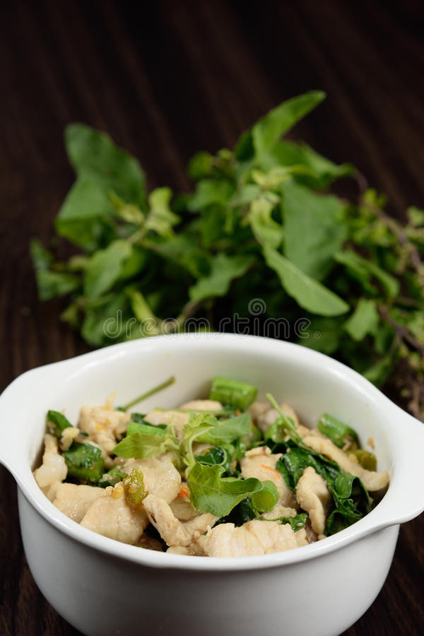 Hot and spicy fried pork with Thai Basil. royalty free stock photo