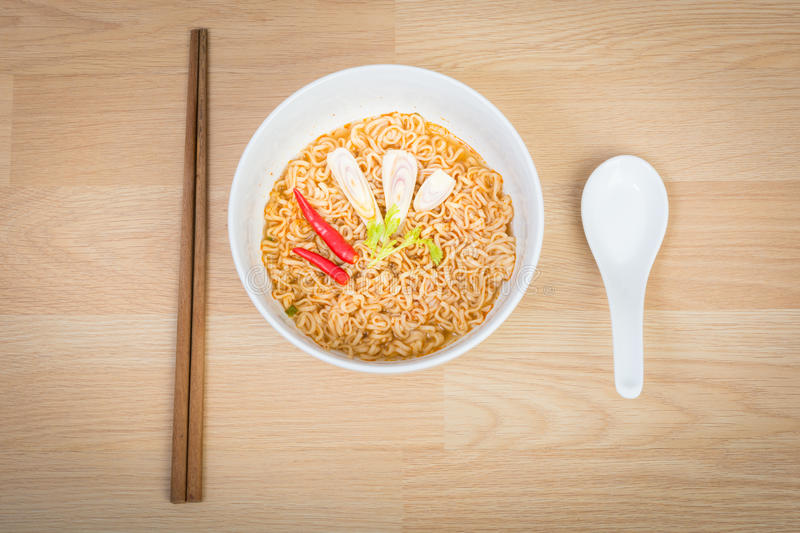 Hot and spicy instant noodle. On wooden background royalty free stock photos