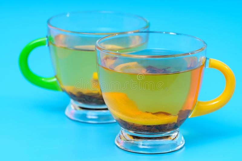 Hot spicy lemon tea in two stylish glass cups stock images