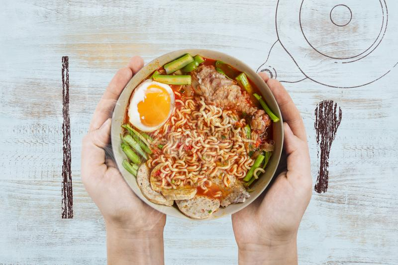 Hot and Spicy noodles in bowl and ingredients on wood background, Korea noodles with boil eggs in bowl with spoon chopsticks and K. Ettle Chalk hand drawing stock image