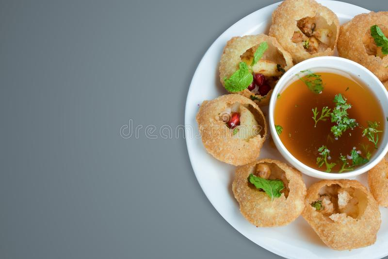 Hot and spicy pani puri indian food photography for restaurant royalty free stock image