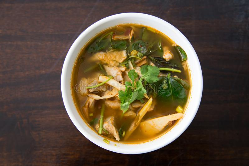 Hot and spicy pork bone with tamarind and Thai herbs soup on bowl stock photography