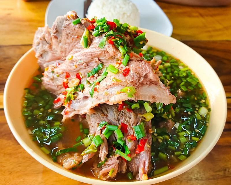 Hot and spicy soup with pork neck bones and Thai herbs that we called stock photography