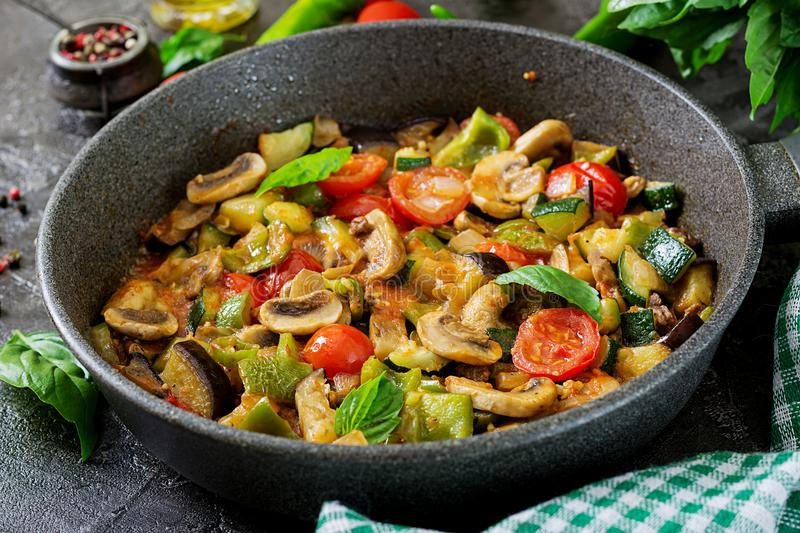 Hot spicy stew eggplant, sweet pepper, tomato, zucchini and mushrooms royalty free stock images