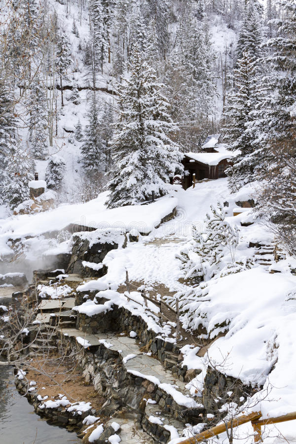 Hot springs. Strawberry Hot Springs surrounded by winter forest stock photography