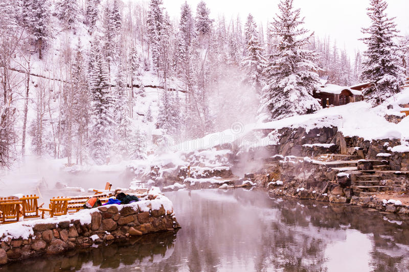 Hot springs. Strawberry Hot Springs surrounded by winter forest stock image
