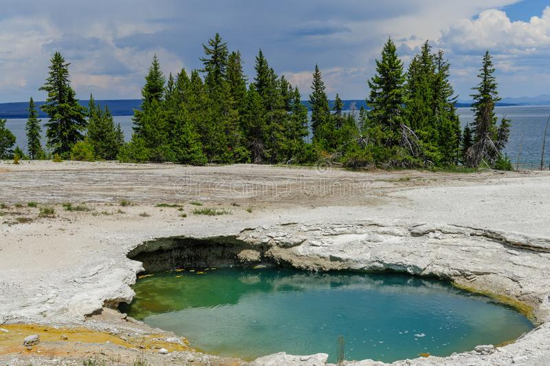 Clear lakes at West Thumb. Hot springs in the West Thumb area in Yellowstone National Park royalty free stock photo