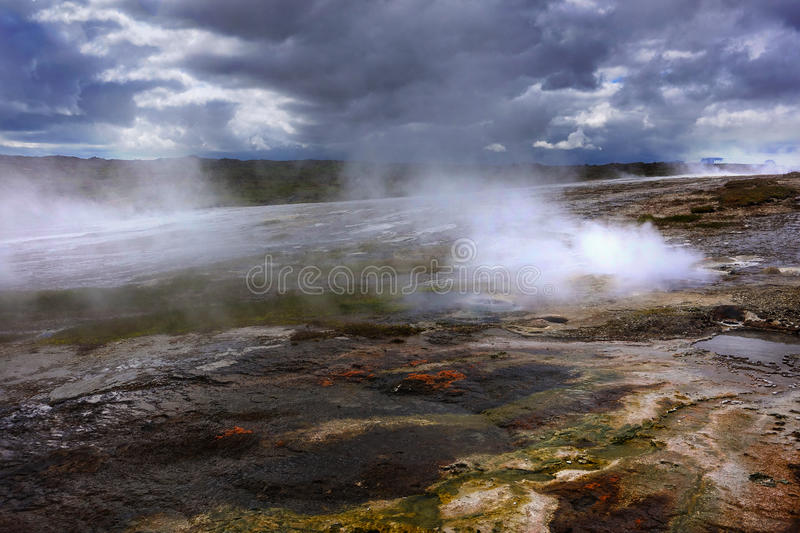 Hot steam over the source of the thermal waters, Hveravellir, Iceland. White nights in Iceland. White nights in beautiful Iceland stock photography