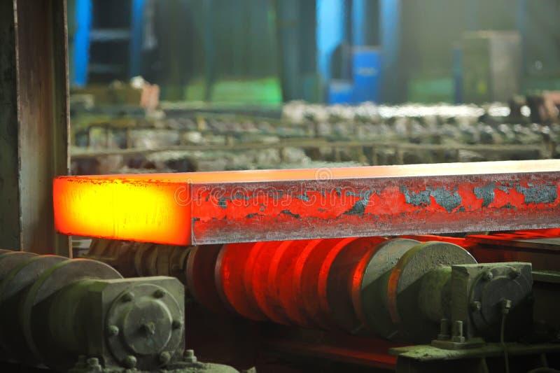 Hot steel on conveyor royalty free stock photography