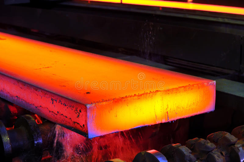Hot steel on conveyor royalty free stock images