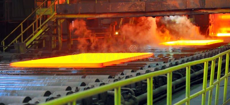 Hot steel on conveyor royalty free stock photo